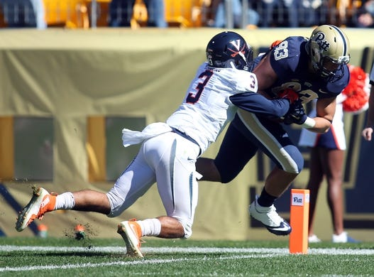 Oct 10, 2015; Pittsburgh, PA, USA; Pittsburgh Panthers tight end Scott Orndoff (83) scores a touchdown against Virginia Cavaliers safety Quin Blanding (3) during the first quarter at Heinz Field. Mandatory Credit: Charles LeClaire-USA TODAY Sports