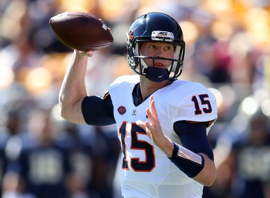 Oct 10, 2015; Pittsburgh, PA, USA; Virginia Cavaliers quarterback Matt Johns (15) passes the ball against the Pittsburgh Panthers during the first quarter at Heinz Field. Mandatory Credit: Charles LeClaire-USA TODAY Sports
