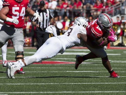Oct 10, 2015; Columbus, OH, USA; Maryland Terrapins linebacker Jermaine Carter Jr. (23) tackles Ohio State Buckeyes running back Ezekiel Elliott (15) at Ohio Stadium. Mandatory Credit: Greg Bartram-USA TODAY Sports