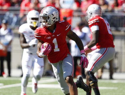 Oct 10, 2015; Columbus, OH, USA; Ohio State Buckeyes wide receiver Braxton Miller (1) runs the ball during the second quarter versus the Maryland Terrapins at Ohio Stadium. Mandatory Credit: Joe Maiorana-USA TODAY Sports