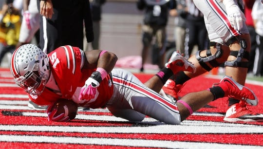 Oct 10, 2015; Columbus, OH, USA; Ohio State Buckeyes running back Ezekiel Elliott (15) dives in for the touchdown during the second quarter versus the Maryland Terrapins at Ohio Stadium. Mandatory Credit: Joe Maiorana-USA TODAY Sports
