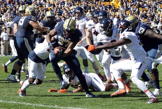 Oct 10, 2015; Pittsburgh, PA, USA; Pittsburgh Panthers running back Qadree Ollison (37) rushes for a four yard touchdown against the Virginia Cavaliers during the first quarter at Heinz Field. Mandatory Credit: Charles LeClaire-USA TODAY Sports