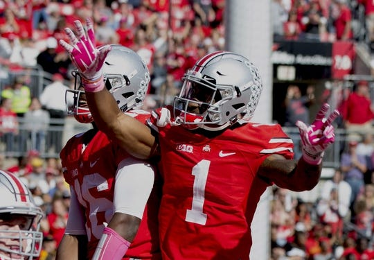 Oct 10, 2015; Columbus, OH, USA; Ohio State Buckeyes wide receiver Braxton Miller (1) and quarterback J.T. Barrett (16) celebrate after Barrett's touchdown run against the Maryland Terrapins at Ohio Stadium. Ohio State won the game 49-28. Mandatory Credit: Greg Bartram-USA TODAY Sports