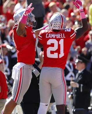 Oct 10, 2015; Columbus, OH, USA; Ohio State Buckeyes running back Jalin Marshall (17) celebrates his  touchdown catch with teammate Parris Campbell (21) during the third quarter versus the Maryland Terrapins at Ohio Stadium. Mandatory Credit: Joe Maiorana-USA TODAY Sports