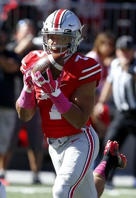 Oct 10, 2015; Columbus, OH, USA; Ohio State Buckeyes running back Jalin Marshall (17) catches touchdown pass during the third quarter versus the Maryland Terrapins at Ohio Stadium. Mandatory Credit: Joe Maiorana-USA TODAY Sports