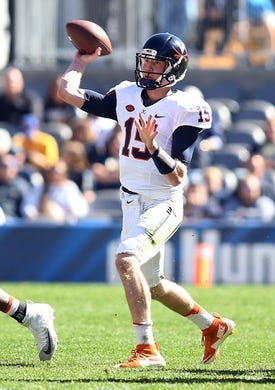 Oct 10, 2015; Pittsburgh, PA, USA; Virginia Cavaliers quarterback Matt Johns (15) passes the ball against the Pittsburgh Panthers during the third quarter at Heinz Field. PITT won 26-19. Mandatory Credit: Charles LeClaire-USA TODAY Sports