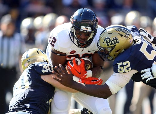 Oct 10, 2015; Pittsburgh, PA, USA; Virginia Cavaliers running back Daniel Hamm (22) is tackled for a loss by Pittsburgh Panthers linebacker Mike Caprara (30) and defensive lineman Shakir Soto (52) during the third quarter against at Heinz Field. PITT won 26-19. Mandatory Credit: Charles LeClaire-USA TODAY Sports