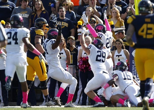 Oct 10, 2015; Toledo, OH, USA; Kent State Golden Flashes linebacker Ryan Seibert (not pictured) jumps on the loose ball in the end zone for a touchdown during the first quarter against the Toledo Rockets at Glass Bowl. Mandatory Credit: Raj Mehta-USA TODAY Sports
