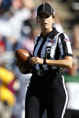 Oct 10, 2015; Toledo, OH, USA; Game official Amanda Sauer walks with the all during the first quarter in the game between the Toledo Rockets and the Kent State Golden Flashes at Glass Bowl. Mandatory Credit: Raj Mehta-USA TODAY Sports
