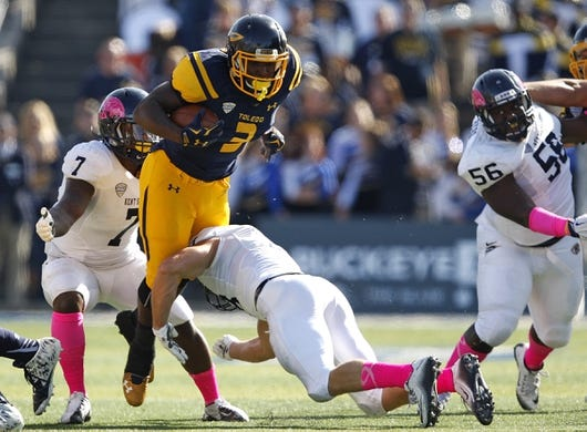 Oct 10, 2015; Toledo, OH, USA; Toledo Rockets running back Kareem Hunt (3) gets tackled by Kent State Golden Flashes safety Nate Holley (18) during the first quarter at Glass Bowl. Mandatory Credit: Raj Mehta-USA TODAY Sports