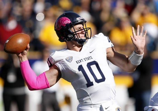 Oct 10, 2015; Toledo, OH, USA; Kent State Golden Flashes quarterback Colin Reardon (10) throws the ball during the first quarter against the Toledo Rockets at Glass Bowl. Mandatory Credit: Raj Mehta-USA TODAY Sports