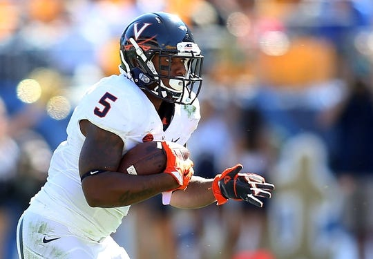 Oct 10, 2015; Pittsburgh, PA, USA; Virginia Cavaliers running back Albert Reid (5) carries the ball against the Pittsburgh Panthers during the third quarter at Heinz Field. PITT won 26-19. Mandatory Credit: Charles LeClaire-USA TODAY Sports