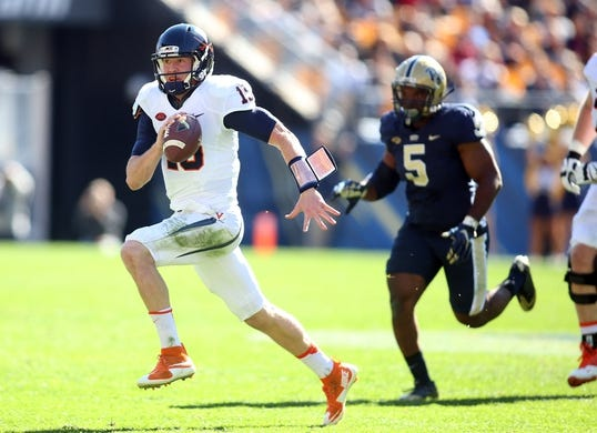 Oct 10, 2015; Pittsburgh, PA, USA; Virginia Cavaliers quarterback Matt Johns (15) runs with the ball as Pittsburgh Panthers defensive lineman Ejuan Price (5) chases during the third quarter  at Heinz Field. PITT won 26-19. Mandatory Credit: Charles LeClaire-USA TODAY Sports