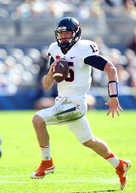 Oct 10, 2015; Pittsburgh, PA, USA; Virginia Cavaliers quarterback Matt Johns (15) runs with the ball against the Pittsburgh Panthers during the third quarter  at Heinz Field. PITT won 26-19. Mandatory Credit: Charles LeClaire-USA TODAY Sports