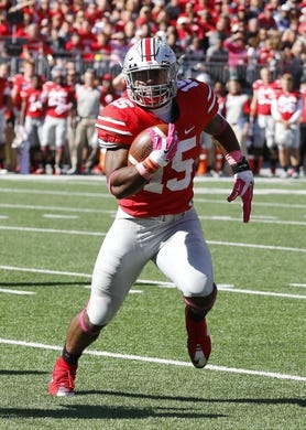 Oct 10, 2015; Columbus, OH, USA; Ohio State Buckeyes running back Ezekiel Elliott (15) runs against the Maryland Terrapins in the second half at Ohio Stadium. Mandatory Credit: Joe Maiorana-USA TODAY Sports
