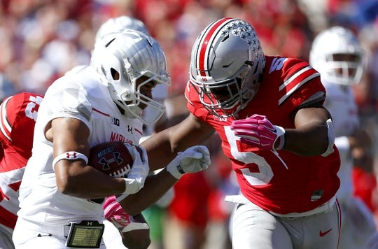 Oct 10, 2015; Columbus, OH, USA; Ohio State Buckeyes linebacker Raekwon McMillan (5) stops Maryland Terrapins running back Wes Brown (5) for no gain during the second half at Ohio Stadium. Mandatory Credit: Joe Maiorana-USA TODAY Sports