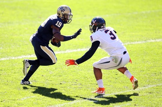 Oct 10, 2015; Pittsburgh, PA, USA; Pittsburgh Panthers wide receiver Dontez Ford (19) runs after a catch as Virginia Cavaliers safety Quin Blanding (3) defends during the fourth quarter at Heinz Field. PITT won 26-19. Mandatory Credit: Charles LeClaire-USA TODAY Sports