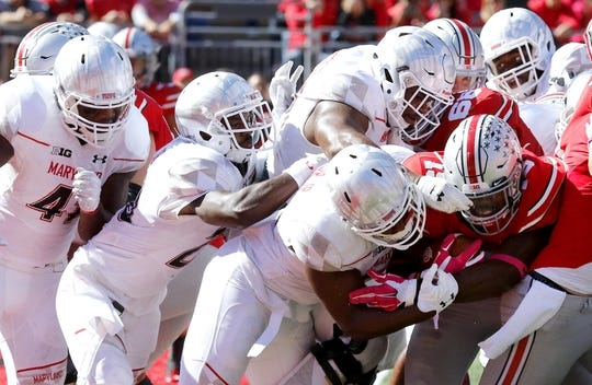Oct 10, 2015; Columbus, OH, USA; Ohio State Buckeyes running back Ezekiel Elliott (15) is stopped at the goal line by a group of Maryland Terrapins defenders during the second half at Ohio Stadium. Ohio State won the game 49-28 to remain unbeaten. Mandatory Credit: Joe Maiorana-USA TODAY Sports