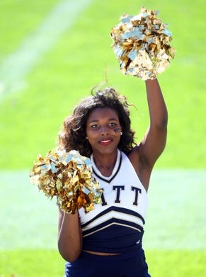 Oct 10, 2015; Pittsburgh, PA, USA; A Pittsburgh Panthers cheerleader cheers against the Virginia Cavaliers during the fourth quarter at Heinz Field. PITT won 26-19. Mandatory Credit: Charles LeClaire-USA TODAY Sports