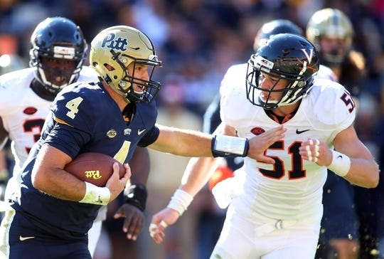 Oct 10, 2015; Pittsburgh, PA, USA; Pittsburgh Panthers quarterback Nathan Peterman (4) carries the ball against Virginia Cavaliers linebacker Zach Bradshaw (51) during the fourth quarter at Heinz Field. PITT won 26-19. Mandatory Credit: Charles LeClaire-USA TODAY Sports
