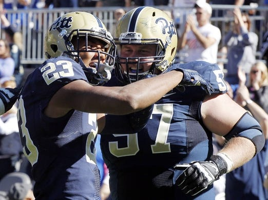 Oct 10, 2015; Pittsburgh, PA, USA; Pittsburgh Panthers wide receiver Tyler Boyd (23) and offensive lineman Artie Rowell (57) celebrate a touchdown by Boyd against the Virginia Cavaliers during the third quarter at Heinz Field. PITT won 26-19. Mandatory Credit: Charles LeClaire-USA TODAY Sports