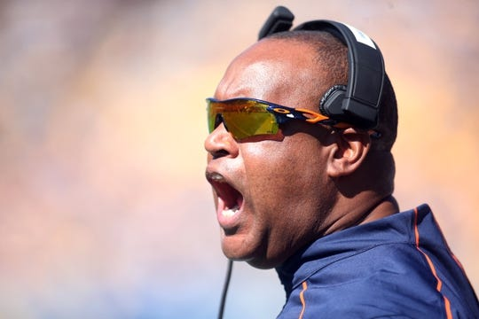Oct 10, 2015; Pittsburgh, PA, USA; Virginia Cavaliers head coach Mike London reacts on the sidelines against the Pittsburgh Panthers during the first quarter at Heinz Field. Mandatory Credit: Charles LeClaire-USA TODAY Sports