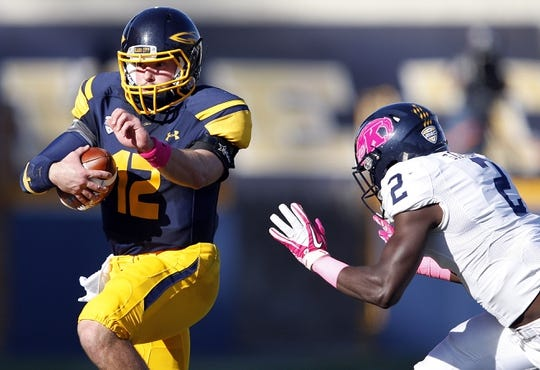 Oct 10, 2015; Toledo, OH, USA; Kent State Golden Flashes safety Erik Simpson (2) runs at Toledo Rockets quarterback Phillip Ely (12) during the second quarter at Glass Bowl. Mandatory Credit: Raj Mehta-USA TODAY Sports