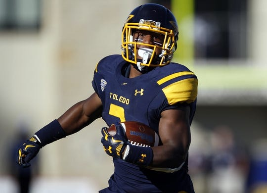 Oct 10, 2015; Toledo, OH, USA; Toledo Rockets running back Terry Swanson (2) makes a long run during the second quarter against the Kent State Golden Flashes at Glass Bowl. Mandatory Credit: Raj Mehta-USA TODAY Sports