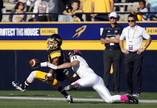 Oct 10, 2015; Toledo, OH, USA; Kent State Golden Flashes wide receiver Connor Arlia (11) defended by Toledo Rockets defensive back DeJuan Rogers (23) during the second quarter at Glass Bowl. Mandatory Credit: Raj Mehta-USA TODAY Sports