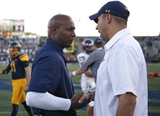 Oct 10, 2015; Toledo, OH, USA; Kent State Golden Flashes head coach Paul Haynes (left) shakes hands with Toledo Rockets head coach Matt Campbell (right) after the game at Glass Bowl. The Rockets won 38-7. Mandatory Credit: Raj Mehta-USA TODAY Sports