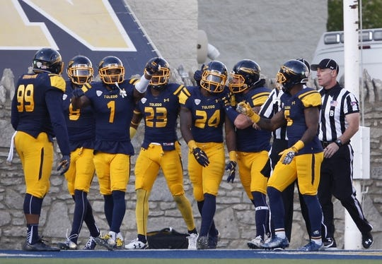 Oct 10, 2015; Toledo, OH, USA; Toledo Rockets safety Rolan Milligan (24) is congratulated by his teammates after making an interception against the Kent State Golden Flashes during the third quarter at Glass Bowl. The Rockets won 38-7. Mandatory Credit: Raj Mehta-USA TODAY Sports