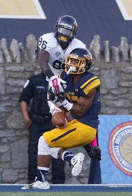 Oct 10, 2015; Toledo, OH, USA; Toledo Rockets cornerback Josh Teachey (32) breaks up a play intended for Kent State Golden Flashes wide receiver Zaquon Tyson (86) during the third quarter at Glass Bowl. The Rockets won 38-7. Mandatory Credit: Raj Mehta-USA TODAY Sports