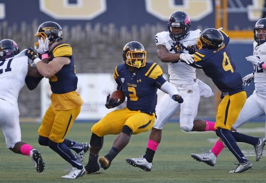 Oct 10, 2015; Toledo, OH, USA; Toledo Rockets running back Kareem Hunt (3) runs with the ball during the third quarter against the Kent State Golden Flashes at Glass Bowl. The Rockets won 38-7. Mandatory Credit: Raj Mehta-USA TODAY Sports