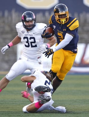Oct 10, 2015; Toledo, OH, USA; Toledo Rockets running back Kareem Hunt (3) breaks a tackle by Kent State Golden Flashes safety Jordan Italiano (23) during the third quarter at Glass Bowl. The Rockets won 38-7. Mandatory Credit: Raj Mehta-USA TODAY Sports