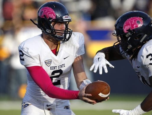 Oct 10, 2015; Toledo, OH, USA; Kent State Golden Flashes quarterback George Bollas (2) hands the ball off to running back Trayion Durham (34) during the third quarter against the Toledo Rockets at Glass Bowl. Rockets win 38-7. Mandatory Credit: Raj Mehta-USA TODAY Sports