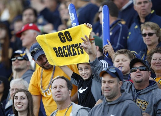 Oct 10, 2015; Toledo, OH, USA; Toledo Rockets fans cheer during the fourth quarter against the Kent State Golden Flashes at Glass Bowl. Rockets win 38-7. Mandatory Credit: Raj Mehta-USA TODAY Sports