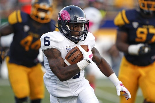 Oct 10, 2015; Toledo, OH, USA; Kent State Golden Flashes wide receiver P.J. Simmons (6) runs the ball during the fourth quarter against the Toledo Rockets at Glass Bowl. Rockets win 38-7. Mandatory Credit: Raj Mehta-USA TODAY Sports