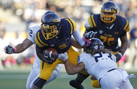 Oct 10, 2015; Toledo, OH, USA; Toledo Rockets running back Kareem Hunt (3) runs the ball against Kent State Golden Flashes safety Jordan Italiano (23) during the fourth quarter at Glass Bowl. Rockets win 38-7. Mandatory Credit: Raj Mehta-USA TODAY Sports