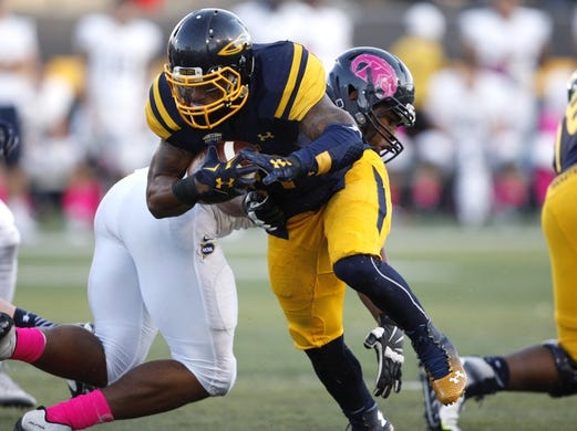 Oct 10, 2015; Toledo, OH, USA; Toledo Rockets running back Marc Remy (21) runs the ball during the fourth quarter against the Kent State Golden Flashes at Glass Bowl. Rockets win 38-7. Mandatory Credit: Raj Mehta-USA TODAY Sports