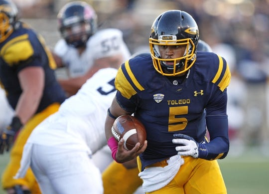Oct 10, 2015; Toledo, OH, USA; Toledo Rockets quarterback Michael Julian (5) runs the ball during the fourth quarter against the Kent State Golden Flashes at Glass Bowl. Rockets win 38-7. Mandatory Credit: Raj Mehta-USA TODAY Sports