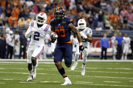 Oct 10, 2015; San Antonio, TX, USA; UTSA Roadrunners wide receiver JaBryce Taylor (83) runs the ball past Louisiana Tech Bulldogs safety Secdrick Cooper (2) for a touchdown during the second half at Alamodome. Mandatory Credit: Soobum Im-USA TODAY Sports