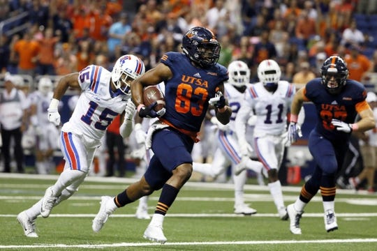 Oct 10, 2015; San Antonio, TX, USA; UTSA Roadrunners wide receiver JaBryce Taylor (83) runs the ball for a touchdown against the Louisiana Tech Bulldogs during the second half at Alamodome. Mandatory Credit: Soobum Im-USA TODAY Sports
