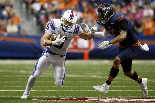Oct 10, 2015; San Antonio, TX, USA; Louisiana Tech Bulldogs wide receiver Trent Taylor (5) runs the ball as UTSA Roadrunners safety Nate Gaines (R) defends during the second half at Alamodome. Mandatory Credit: Soobum Im-USA TODAY Sports