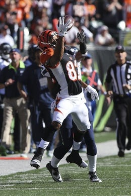 Oct 11, 2015; Cincinnati, OH, USA; Cincinnati Bengals wide receiver Marvin Jones (82) attempts a catch in the second half against the Seattle Seahawks at Paul Brown Stadium. The Bengals won 27-24. Mandatory Credit: Aaron Doster-USA TODAY Sports