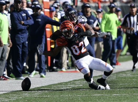 Oct 11, 2015; Cincinnati, OH, USA; Cincinnati Bengals wide receiver Marvin Jones (82) is unable to make a catch as he is interfered with by Seattle Seahawks cornerback Cary Williams (26) in the second half at Paul Brown Stadium. The Bengals won 27-24. Mandatory Credit: Aaron Doster-USA TODAY Sports