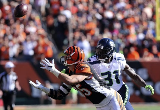 Oct 11, 2015; Cincinnati, OH, USA; Cincinnati Bengals tight end Tyler Eifert (85) makes a catch while being defended by Seattle Seahawks strong safety Kam Chancellor (31) in the second half at Paul Brown Stadium. The Bengals won 27-24. Mandatory Credit: Aaron Doster-USA TODAY Sports