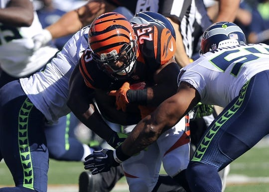 Oct 11, 2015; Cincinnati, OH, USA; Cincinnati Bengals running back Giovani Bernard (25) carries the ball in the second half against the Seattle Seahawks at Paul Brown Stadium. The Bengals won 27-24. Mandatory Credit: Aaron Doster-USA TODAY Sports