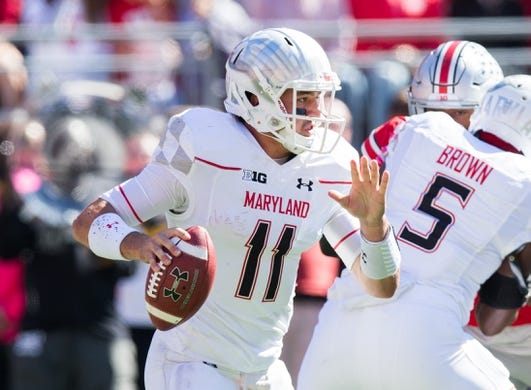 Oct 10, 2015; Columbus, OH, USA; Maryland Terrapins quarterback Perry Hills (11) looks for an open receiver against the Ohio State Buckeyes at Ohio Stadium. Ohio State won the game 49-28. Mandatory Credit: Greg Bartram-USA TODAY Sports