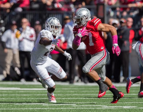 Oct 10, 2015; Columbus, OH, USA; Ohio State Buckeyes running back Jalin Marshall (7) carries the ball past Maryland Terrapins defensive back Sean Davis (21) at Ohio Stadium. Ohio State won the game 49-28. Mandatory Credit: Greg Bartram-USA TODAY Sports