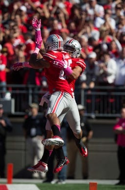 Oct 10, 2015; Columbus, OH, USA; Ohio State Buckeyes running back Jalin Marshall (7) celebrates with tight end Marcus Baugh (85) after scoring against the Maryland Terrapins at Ohio Stadium. Ohio State won the game 49-28. Mandatory Credit: Greg Bartram-USA TODAY Sports
